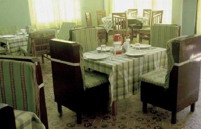 The Komfort Inn - Restaurant - 6