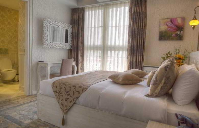 Elegance Asia Hotel - Room - 19
