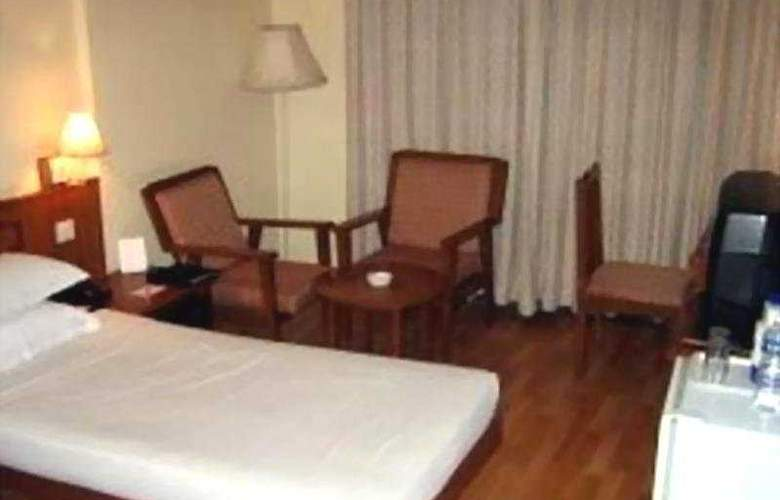 Ramee Guestline Hotel Bangalore - Room - 3