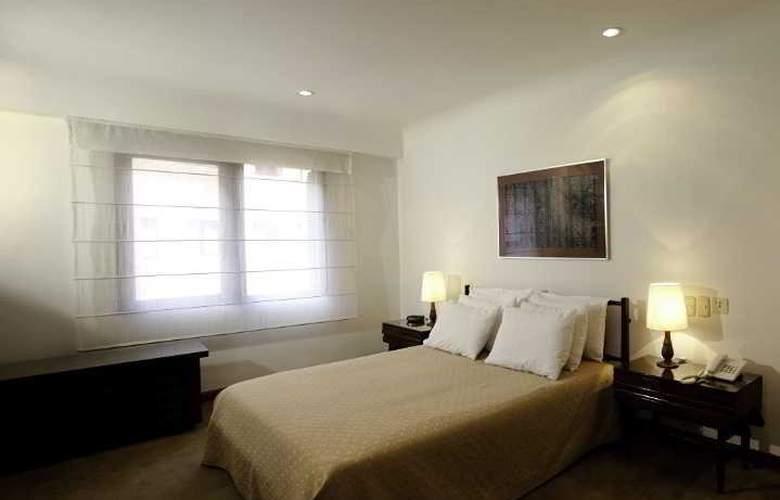 Travelers Apartamentos y Suites CondominioPlenitud - Room - 4
