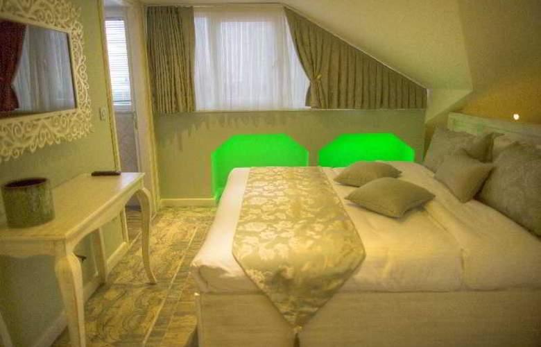 Elegance Asia Hotel - Room - 13