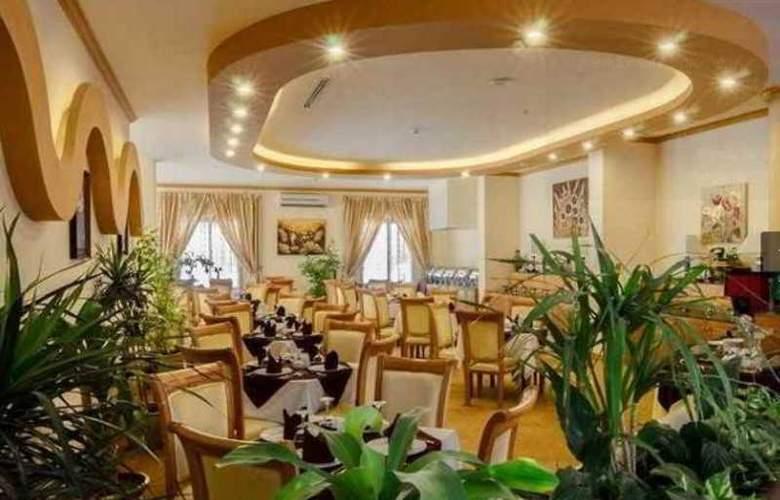Orchid Al Mansour Hotel - Restaurant - 2