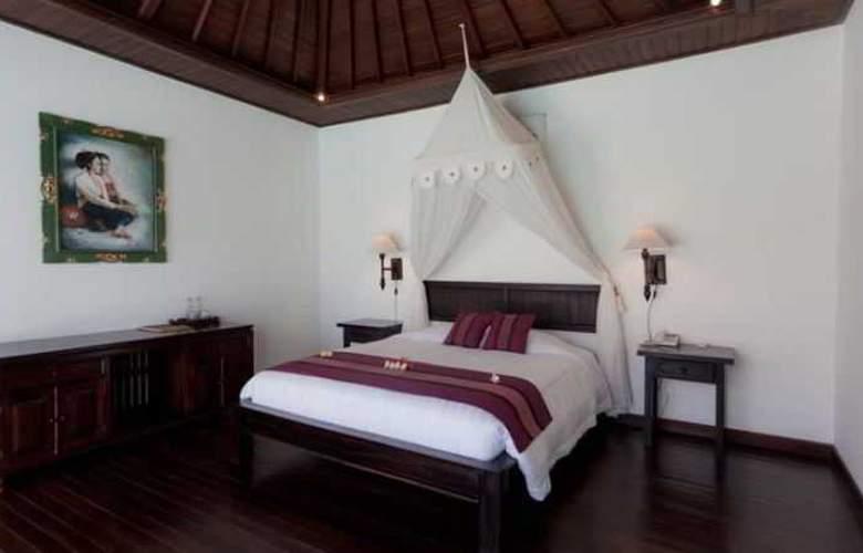 Adi Assri Beach Cottages Singaraja - Room - 14