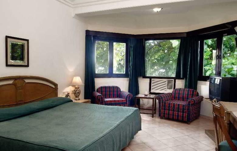 Whispering Palms Beach Resort - Room - 8