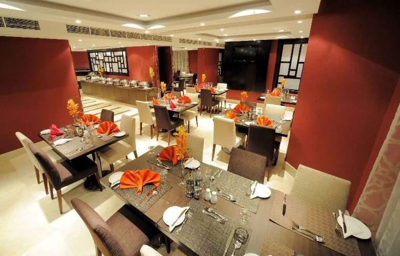 Al Hamra Hotel Sharjah - Restaurant - 8