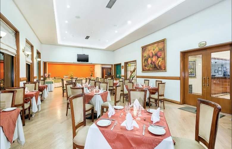 Parque 97 Suites - Restaurant - 20