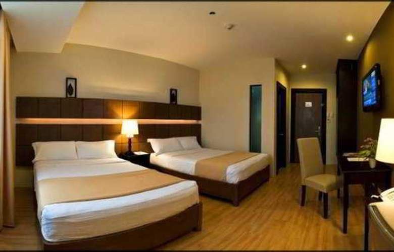 The Pinnacle Hotel and Suites - Room - 0