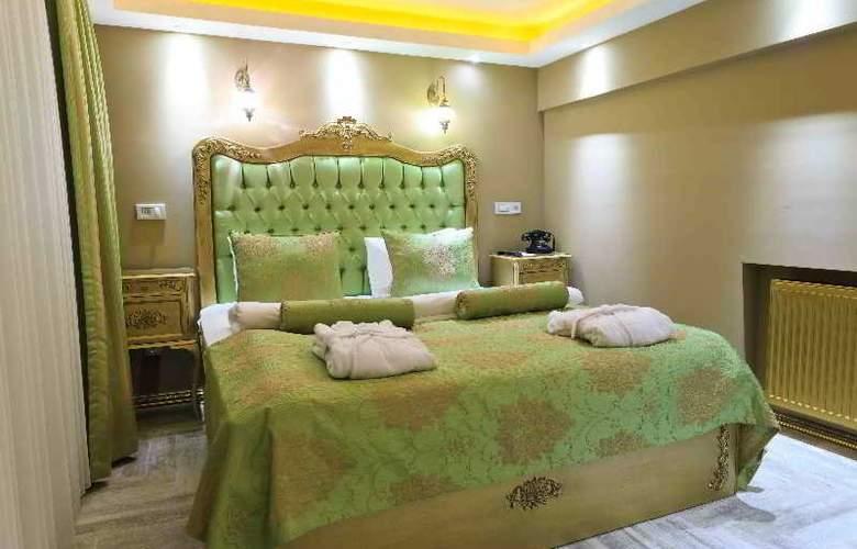 Elegance Asia Hotel - Room - 6