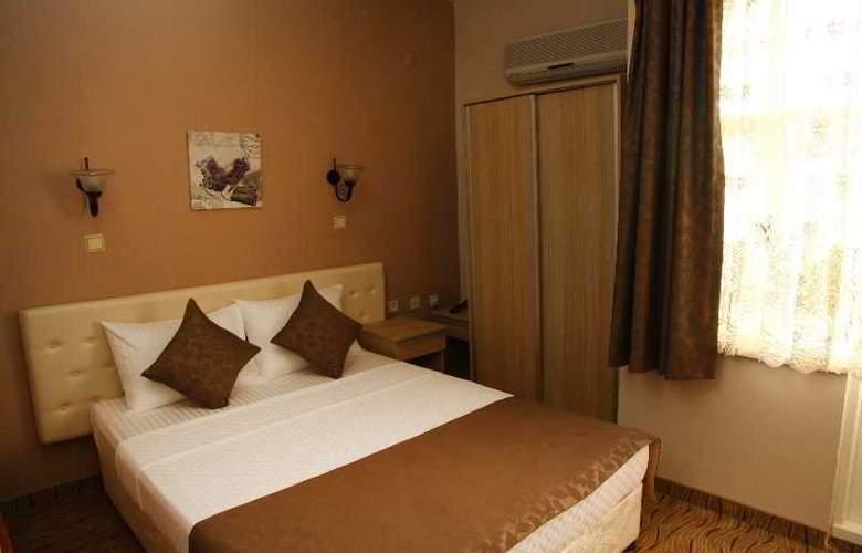 Yasemin Hotel - Room - 6