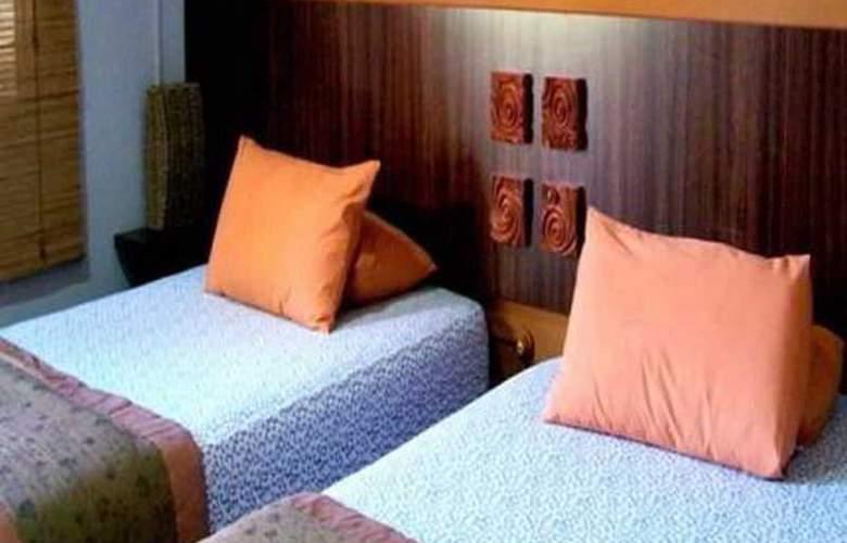 Rasa Eksotika Vacation Home - Room - 6
