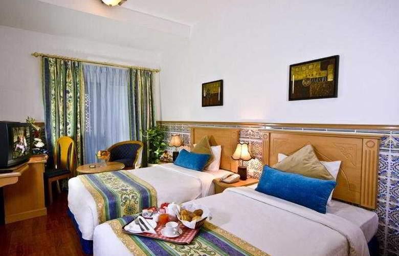 Landmark Plaza - Room - 5