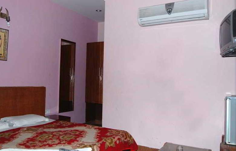 Ambica Deluxe - Room - 2