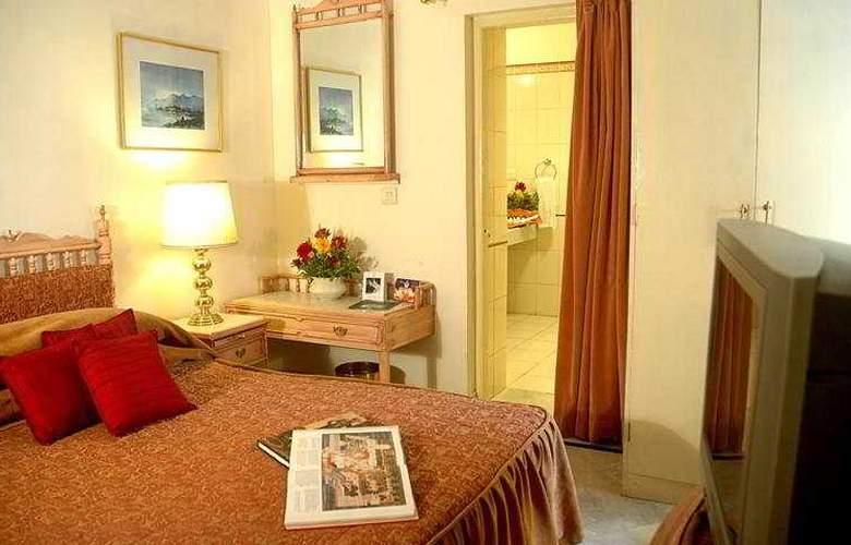 Garden Hotel - Room - 4