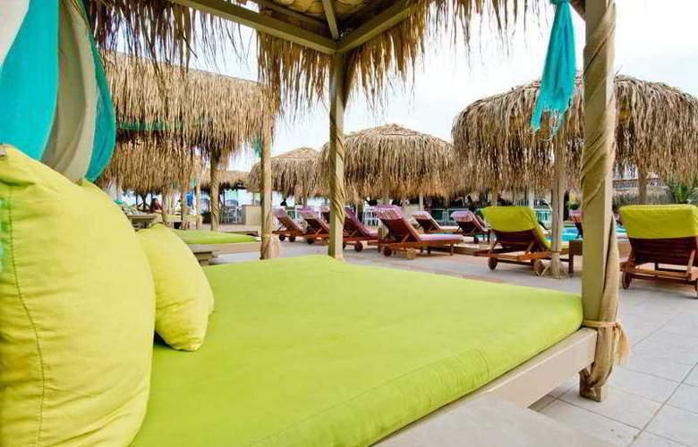 Jojo Beach Hotel & Bar - Beach - 4