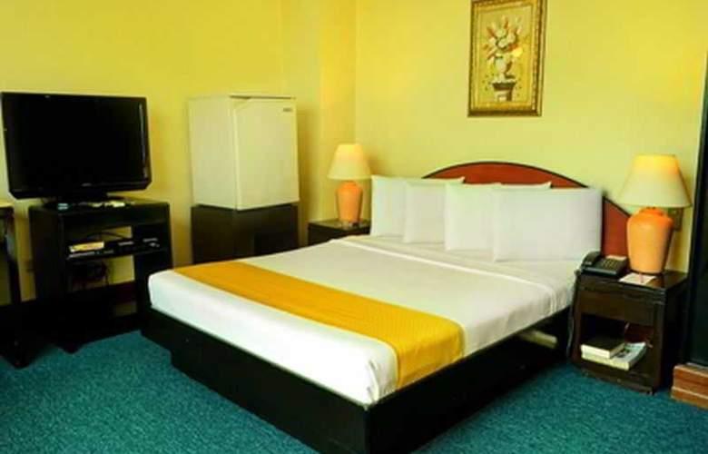 Paragon Suites - Room - 10