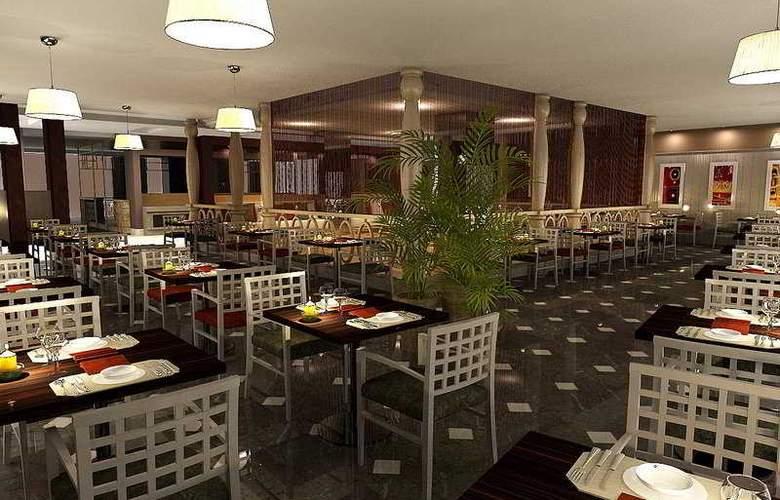 Commodore Elite Suites & Spa - Restaurant - 7