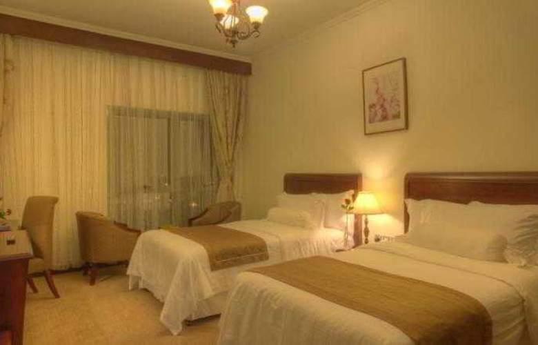 Siji Hotel Apartments - Room - 8
