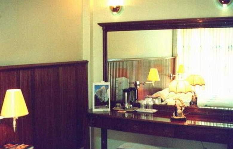 Panda Hotel - Room - 4