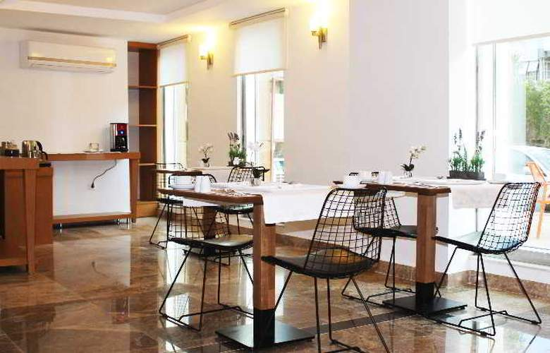 Duru Suites - Restaurant - 4