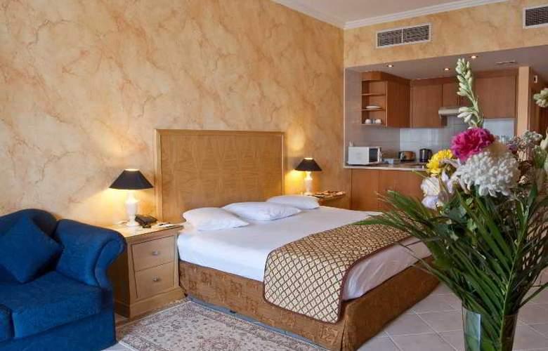 Ramee Hotel Apartment Dubai - Room - 9