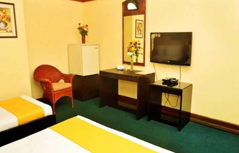 Paragon Suites - Room - 14