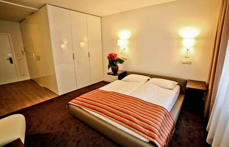 Platinum Palace Serviced Apartments Poznan - Room - 4