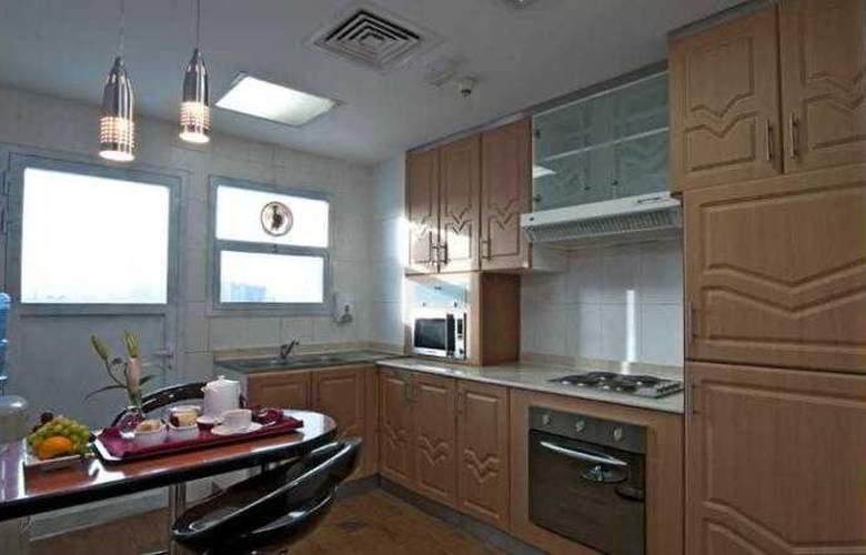 Al Jawhara Hotel Apartments - Room - 13