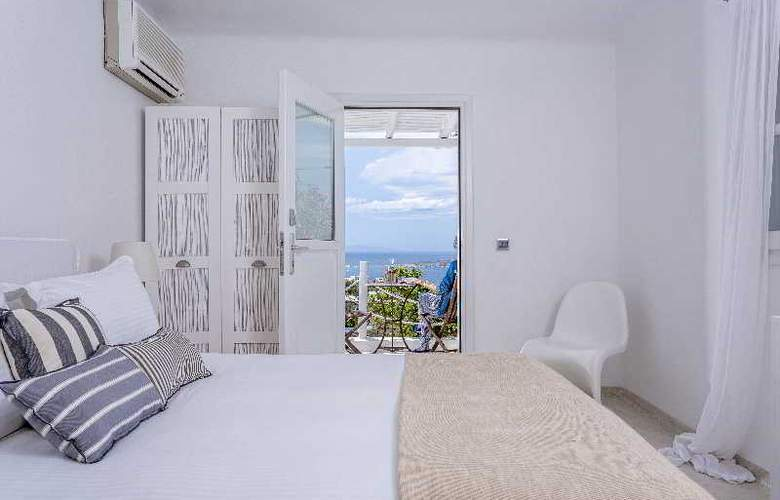 Ostraco Luxury Suites - Room - 11