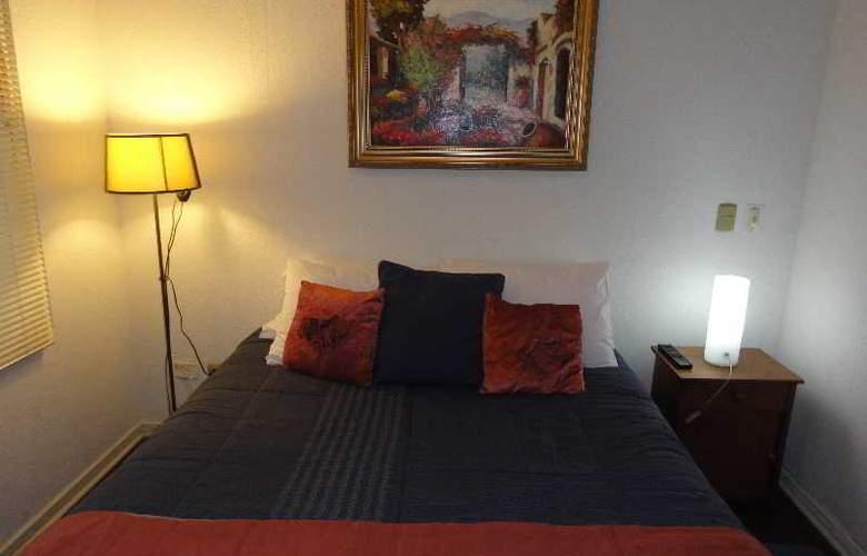 Santiago Apartamentos Centro - Room - 4