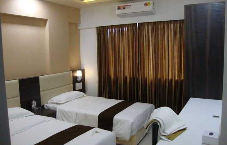 Galaxy Comforts - Room - 9
