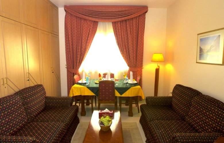 Safeer Hotel Suites - Room - 8