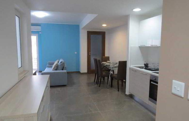 115 The Strand Suites - Room - 8