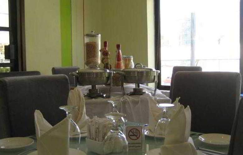 Crystal Suites - Restaurant - 10