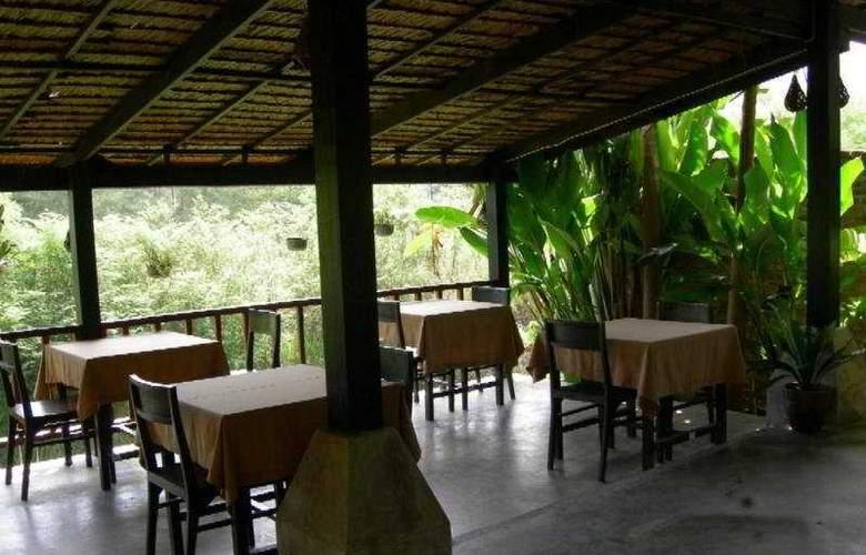 Motive Cottage Resort - Restaurant - 11