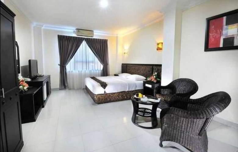 Gaja Hotel Pekanbaru - Room - 2