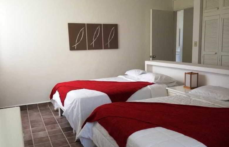 Las Gaviotas Hotel and Suites - Room - 5