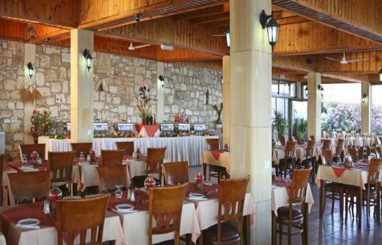 Corallia Beach Apartments - Restaurant - 16