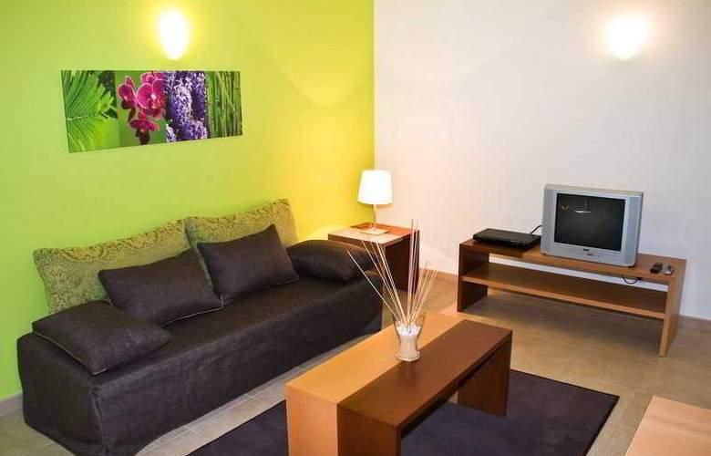 Aquamar Apartamentos - Room - 5