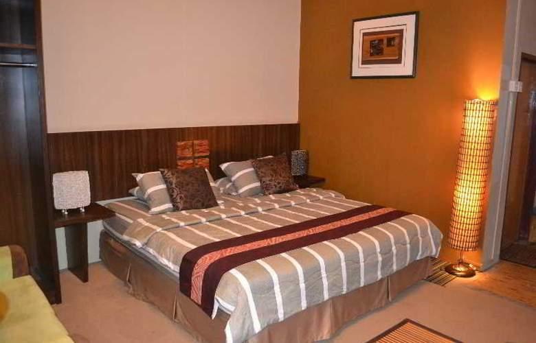 Rasa Eksotika Vacation Home - Room - 12