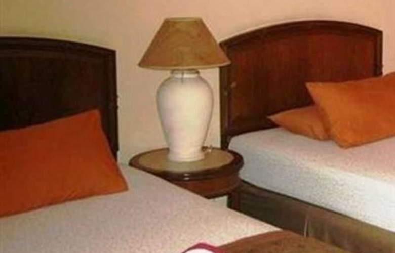 Rasa Eksotika Vacation Home - Room - 14