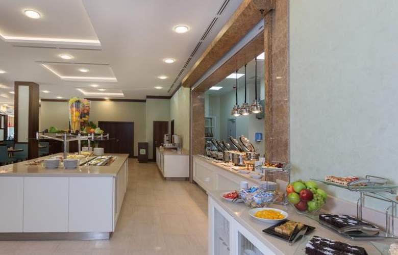 Hilton Garden Inn Astana - Restaurant - 5