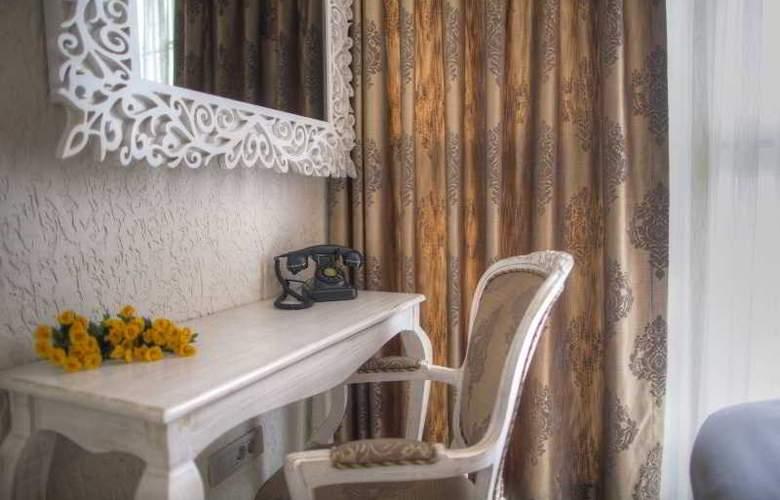 Elegance Asia Hotel - Room - 8