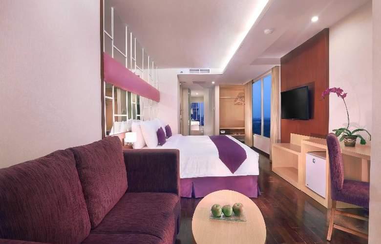 Quest Hotel Surabaya - Room - 1