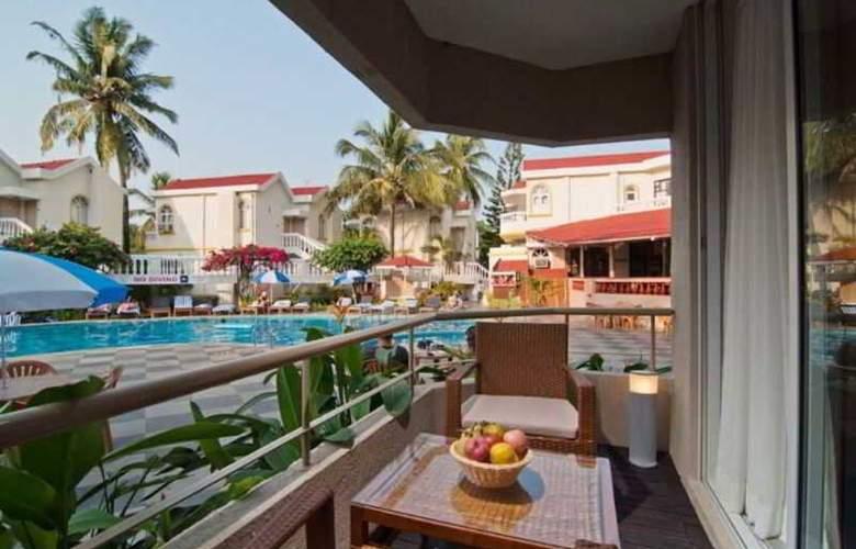 Whispering Palms Beach Resort - Room - 9