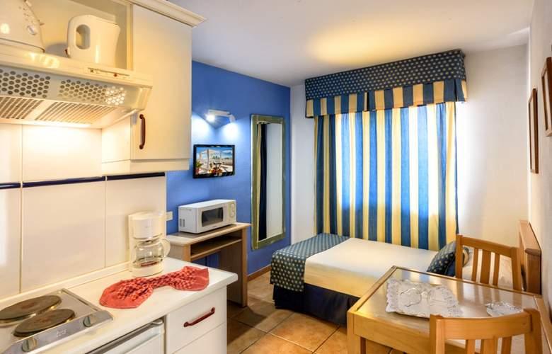 Oro Blanco Apartments - Room - 17