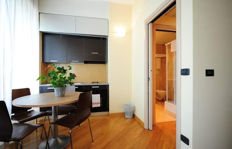 Residence Corvetto Porto di Mare - Room - 8