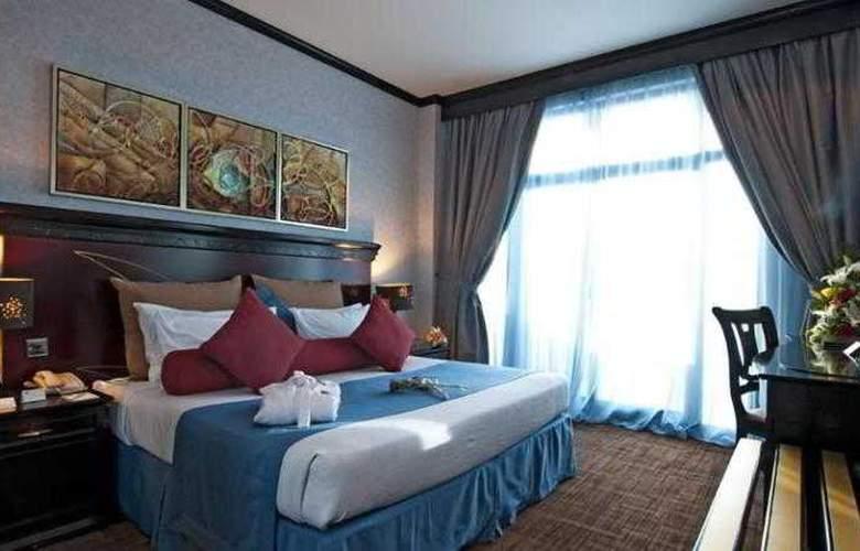 Al Jawhara Gardens - Room - 9
