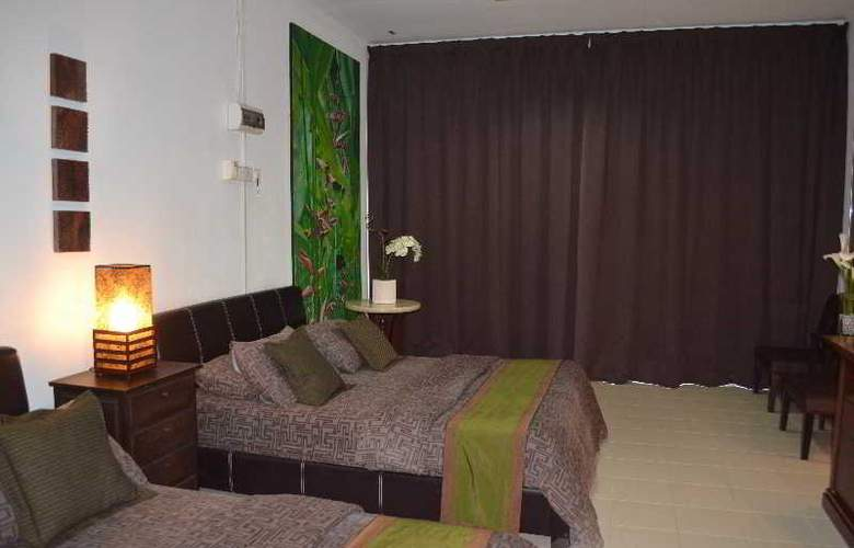 Rasa Eksotika Vacation Home - Room - 10