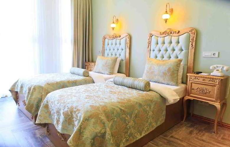 Elegance Asia Hotel - Room - 5
