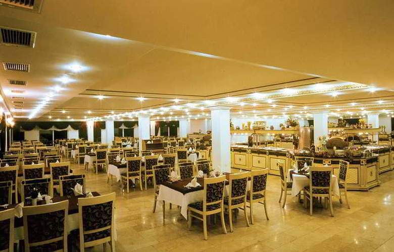 Orient Palace Hotel & Resort - Restaurant - 9